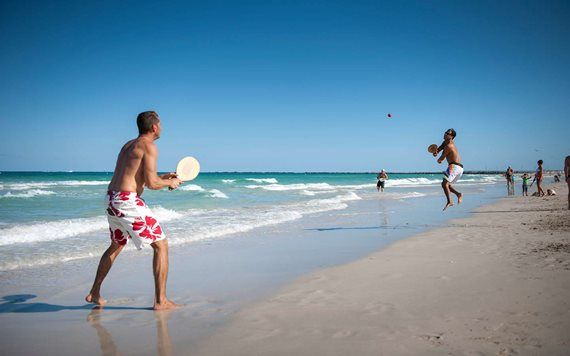 Friends play paddle ball on South Beach