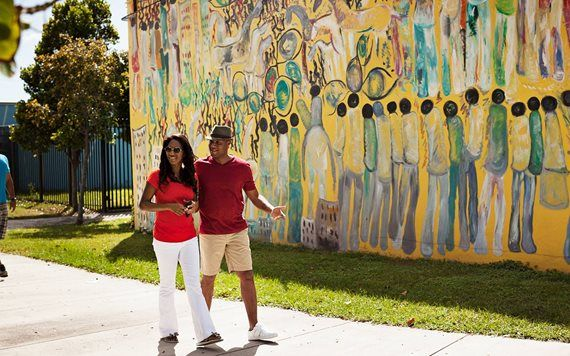 Couple by Purvis Young Mural in Historic Overtown